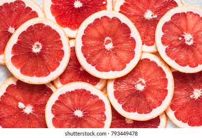 Food background. Cut fresh ripe grapefruit, top view, flat lay. Free space for text