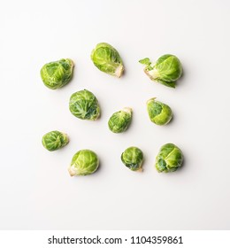 Food background flat lay, brussels sprouts on white background, top view.