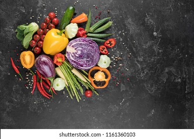 Food background. Fresh farmer vegetables at dark beton table. Space for text.