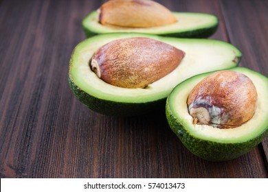 food background with fresh organic avocado on old wooden table, top view, copy space..