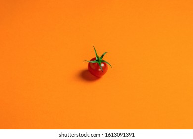 food background. Fresh red cherry tomato or sweet girl, lying alone on a colored lava background, horizontal orientation