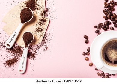 Food background with ground coffee in white spoons, coffee beans and capsules, sugar. Copy space, top view.