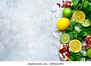 Food background with ingredients for making citrus lemonade on a grey slate, stone or concre table.Top view with copy space.