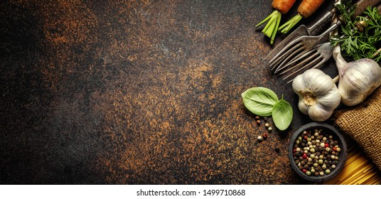 Food background. Italian cuisine. Ingredients on dark  brown background. Cooking concept. Cooking background. Banner