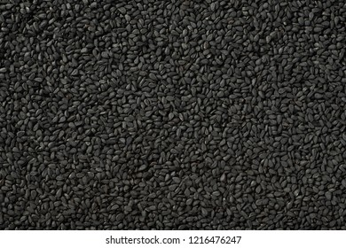 food background of kalonji seeds, top view