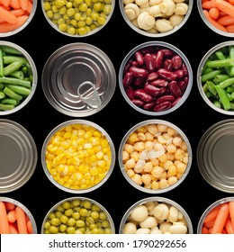 Food background made of opened canned chickpeas, green sprouts, carrots, corn, peas, beans and mushrooms on black background