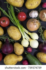 Food background:  organic vegetable on black background, top view