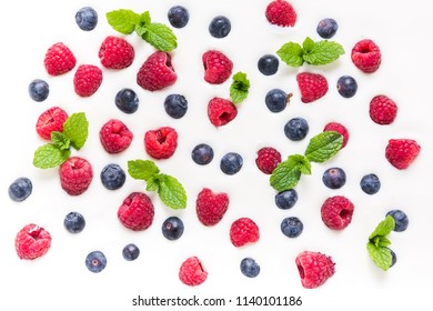 Food background, raspberries and blueberies on yogurt. From above flat lay design.