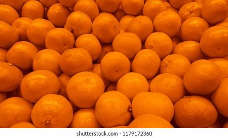 food background of ripe and juicy yellow mandarines (tangerine)