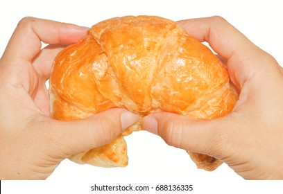 food, baking, people and unhealthy eating concept - close up of woman hands with bun or wheat bread