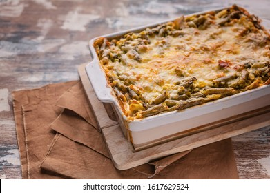 Food banner baked vegetable lasagna with green beans and cheese in a ceramic bowl. Healthy vegetarian food. Copy space