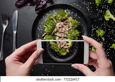 food blogger make mobile photo of vegetable salad. social network activity. proper nutrition lifestyle.