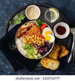 Food bowl. Buddha bowl. Rice, chickpeas with chicken breast, eggs and vegetables top view