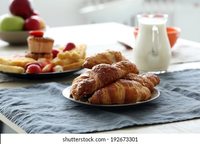 Food, breakfast. Delicious croissants on the table