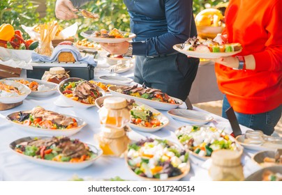 food buffet catering dining eating party sharing concept.beautifully decorated catering banquet table with different food snacks and appetizers on corporate party or wedding celebration.