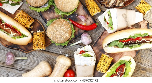 Food Buffet Catering Dining Eating Party Sharing Concept. Food Festival. All kinds of fast food. hot dogs, hamburgers, traditional American food. fast food, Oktoberfest,