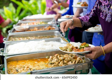 Food Buffet Catering Dining Eating Party Sharing Concept.people group catering buffet food indoor in luxury restaurant with meat colorful fruits and vegetables