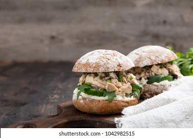 Food burger with tuna, herbs, cucumbers, cottage cheese, onions.