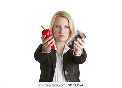 Food Canning Business Concept. Attractive businesswoman holding a fresh red pepper and blank tin in a food canning concept.