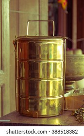 Food carrier brass place on wooden table-Vintage filter