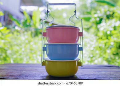 Food carrier colorful on wooden floor,tiffin carrier