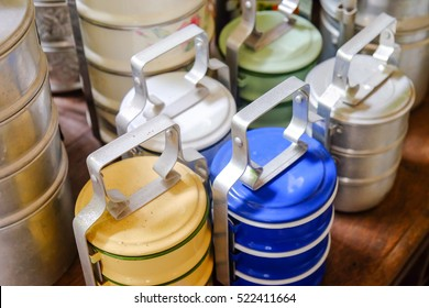 Food carrier, Still life with colorful retro food carrier on wood table background