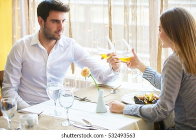 food, christmas, holidays and people concept - smiling couple eating main course at restaurant