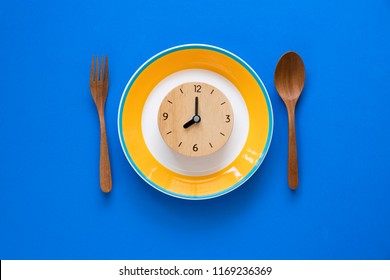 Food clock. Healthy food concept on blue background