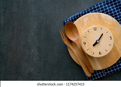 Food clock. Healthy food concept on black table background