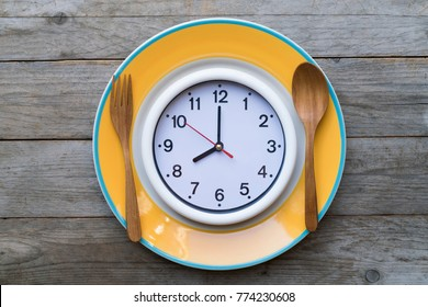 Food clock. Healthy food concept on wooden table
