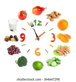 Food clock with healthy food on white background. Food concept