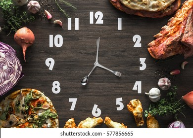 Food clock on the Black wood Laminate, Concept time to eat.