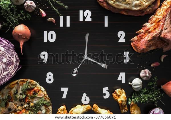 Food clock on the Black wood Laminate.