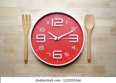 Food clock spoon and fork, Healthy food concept on the table