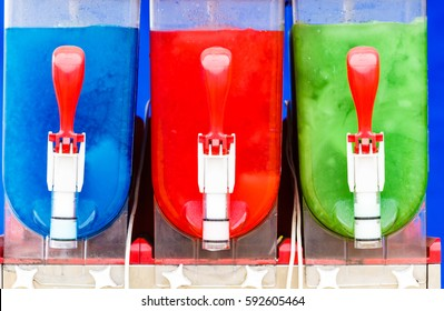 Food, cold sweet desert, summertime pleasure concept. Colorful ice cream slushy smoothie machine