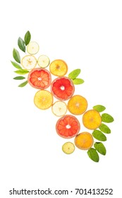 food composition with sliced citrus fruits and leaves, isolated on white