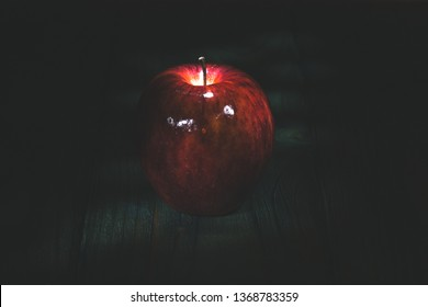 food concept - apple on a wooden board in the darkness
