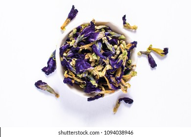 Food concept dry Butterfly pea flower for make the tea in ceramic cup on white background
