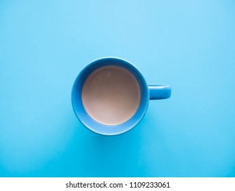 food concept, flat lay of coffee cup blue on blue background.