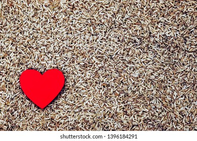 Food concept for healthy wholemeal rice, with a healthy heart, for rice recipes, diet, cooking and loving rice - with design space.