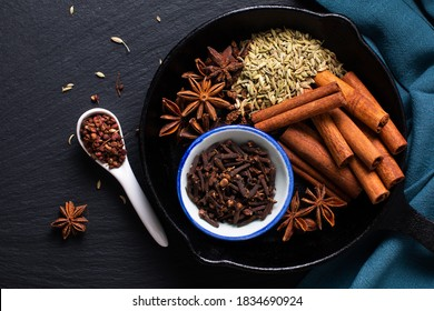 Food concept origin Chinese Five Spice  Star Anise, Fennel Seeds, Szechuan Peppercorns, Whole Cloves and Cinnamon Stick on black rustic background with copy space