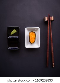 food concept, Sushi, wasabi and chopstick on black background, flat lay, copy space.