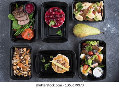 food in containers on a dark background. food delivery. healthy food. over view