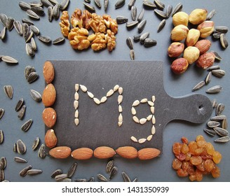Food containing magnesium. Healthy food. Healthy diet eating concept. Magnesium food (almond, sunflower seed, hazelnut, walnut, dry grapes). Food rich in magnesium.