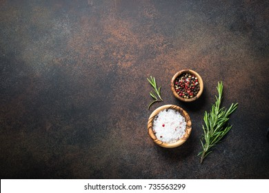 Food cooking background with  spices and herbs on dark stone table. Top view with copy space.