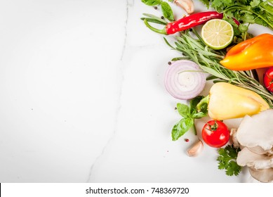Food cooking background, white marble table. Fresh raw organic vegetables (tomatoes, peppers, mushrooms, onion), herbs, spices, lime for preparation dinner. Top view copy space