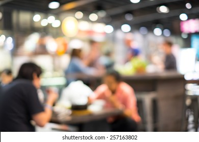 Food court and customer blurred background with bokeh and defocused lights