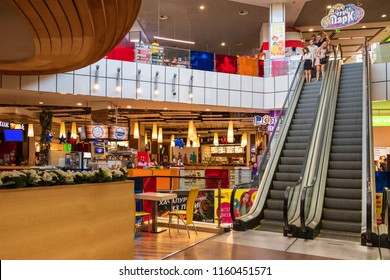"Food court and view of the escalator in the hypermarket ""Dafi"". Kharkov, Ukraine. August 2018."