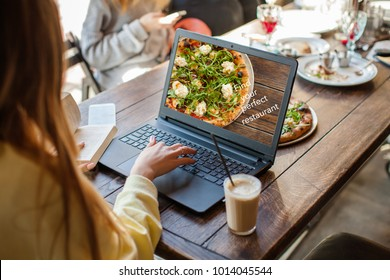 Food Critic or Blogger Writing his Recommendation or a Review of Food and Service in a Restaurant. Classic Italian Pizza on thin crust
