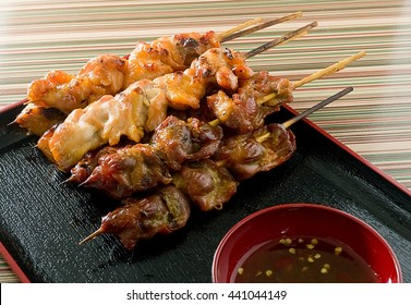 Food and Cuisine, Chicken Grilled or Barbecue Chicken on Wooden Skewer Served with Spicy Sauce.